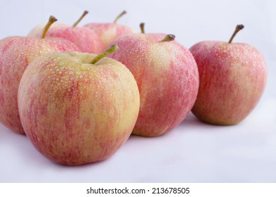 2/3 frame cluster of apples on a white background.