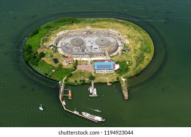 23 June 2018, Muiden, Netherlands. Aerial view of the fortress island Pampus in lake Markermeer in the vicinity of Amsterdam, province Noord Holland. Ships ar in the small harbor.