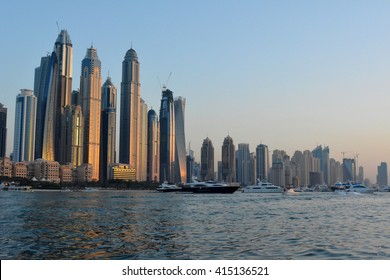 23 March 2016. Photography of many tall buildings, skyscrapers skyline seen from the water from Dubai. United Arab Emirates.