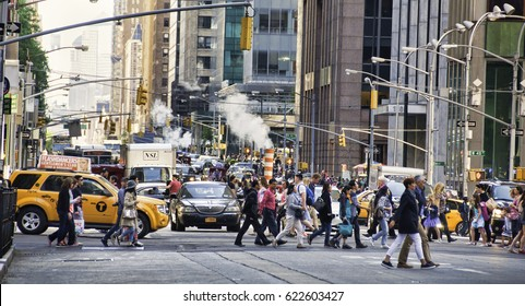 23 May 2015 - New York, USA.  Scene of crowded avenue in New York City. People and cars in a congested environment causing air pollution to American city.