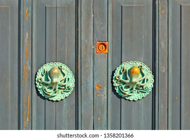 23.03.2019. the bronze handles in the shape of an octopus on the door of a historic building in the village of Tellaro, Lerici Liguria, Italy
