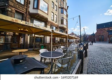 23-03-2020 Riga, Latvia. Empty street cafe on the square of a European city