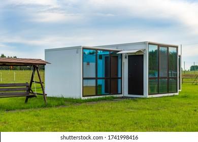 23.05.2020 Russia, Sayzovo farmstead. Modular prefabricated houses made of panels with large panoramic windows.