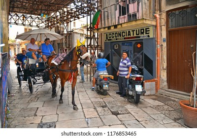 23.08.2018.the carriage with horse takes tourists in the narrow streets of the historic center of Palermo towards the famous street open market Ballaro, Palermo, Sicily Italy