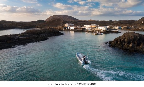 23.12.2017: Boat with tourists on the pier of the island of Lobos, off the coast of Corralejo, on the island of Fuerteventura