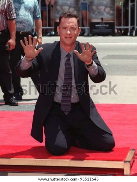 """23JUL98:  Actor TOM HANKS at Mann's ChineseTheatre,  Hollywood, where he had his hand & footprints set in cement.  His new movie, """"Saving Private Ryan,"""" opens this week."""