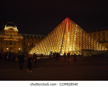 23rd December 2015, Paris, France: Photo shows the Lourve glass pyramid at Paris with a red thunder lighting hanging from the top of the pyramid.