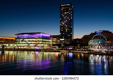 23rd December 2018, Sydney Australia: Night view of Darling Harbour with Sofitel hotel and the International Convention Centre in Sydney NSW Australia