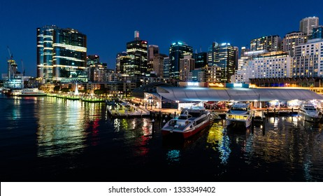 23rd December 2018, Sydney NSW Australia : Scenic night view of Sydney Darling Harbour with King street wharf and marina