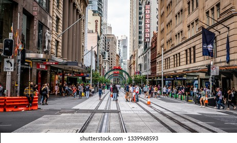 23rd December 2018, Sydney NSW Australia : Streetview of George street with people walking on tram rails in Sydney NSW Australia