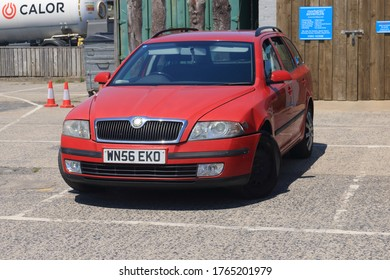 23rd June 2020- A red Skoda Octavia Ambienti Tdi parked in the public carpark at Pendine, Carmarthenshire, Wales, UK.