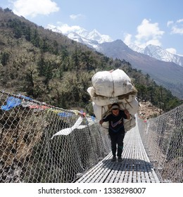24 April 2018, Khumbu Region, Nepal : Local people work as a porter carrying goods to the base camp. Everest Base Camp is the popular route for tourist all around the world