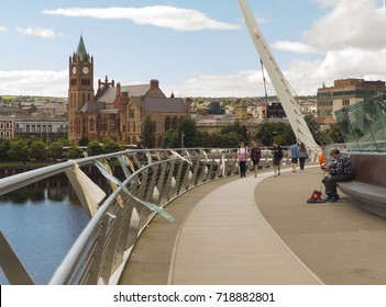 24 August 2016 A view across the River Foyle from the iconic Peace Bridge to the famous Londonderry City Guild Hall