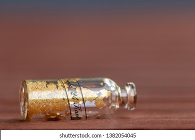 24 carat of gold in a tiny bottle