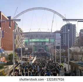 24 Feb 2019 - London, England. People walking Olympic Way towards the Wembley Stadium to watch Carabao Cup finals.