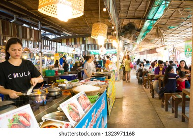 24 February 2019 Cute woman cooking casseroled prawns/shrimps with glass noodles at Khlong Lad Mayom Market, Bang Ramat Subdistrict, Taling Chan District, Bangkok, Thailand.
