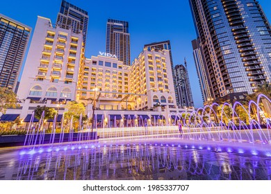 24 February 2021, Dubai, UAE: Vida hotel and illuminated fountain panoramic view in Dubai Marina Creek Harbour