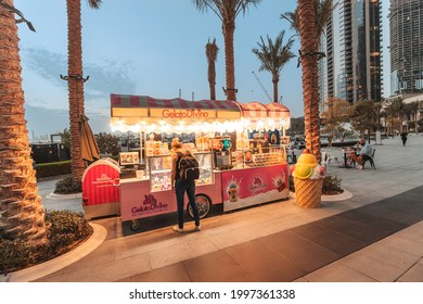 24 February 2021, Dubai, UAE: People buy delicious Gelato Divino ice cream at a kiosk stall on the streets of the city