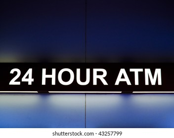 24 Hour ATM sign light up at night
