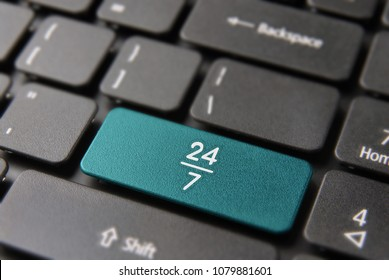 24 hour open business computer keyboard button for 24/7 service concept. Online attention keypad key in blue color.
