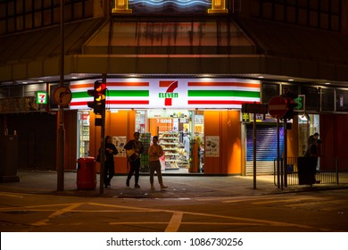 24 hours convenience store 7-11 or 7-Eleven opening all night make bright night road and safety in Hong Kong. 24 November 2017.