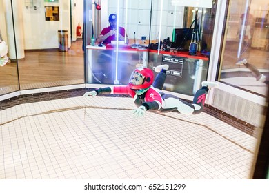 24 MARCH 2017, PRATER PARK, VIENNA, AUSTRIA: The instructor training a sportsman paratrooper in aerodynamic aero tube to do some tricks, the concept of weightlessness and team building