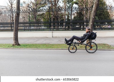 24 MARCH 2017, VIENNA, AUSTRIA: A traveler rides on an unusual recumbent bike