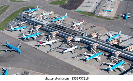 24 March 2019, Amsterdam Holland. Aerial view of terminal E Gate at Schiphol Airport with many jet planes from KLM Royal Dutch Airlines.