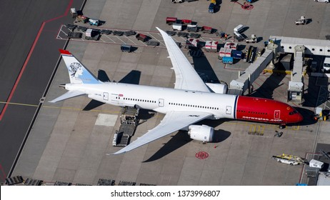 24 March 2019, Amsterdam, Holland. Aerial view of airplane Boeing 787 Dreamliner of Norwegian Airlines at Schiphol International Airport. At the tail of the aircraft a painting of Kirsten Flagstad.