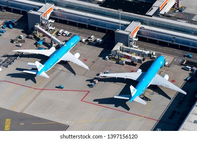 24 March 2019, Amsterdam, Holland. Aerial view at Schiphol International Airport of a KLM Royal Dutch Airlines Boeing 777 and a 787 Dreamliner at the gate. Registration PH-BHF and PH-BQB.