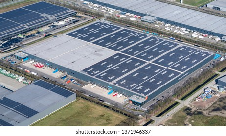 24 March 2019, Tilburg, Holland. Aerial view of headquarter and distribution center of online company Coolblue. The largest dc in The Netherlands with 23000 solar panels on the roof.
