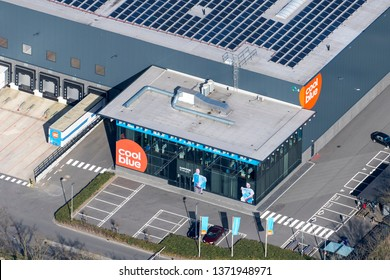24 March 2019, Tilburg, Holland. Aerial view of main entrance headquarter and distribution center of online company Coolblue. The largest dc in The Netherlands. The logo is orange with white letters.