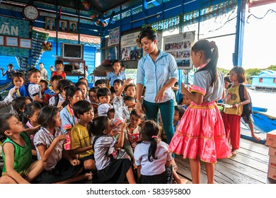 24 october 2015 at phnom penh ,Combodia a teacher is giving some snaks to her children