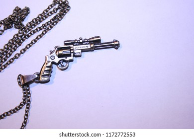 24 Revolver on a necklace