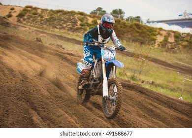24 september 2016 - Volgsk, Russia, MX moto cross racing - Girl Bike Rider rides on a motorcycle, telephoto