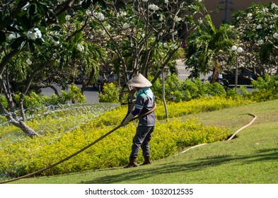 24/02/2018 - Vung Tau city, Vietnam A worker watering plants in the park