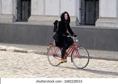 24-03-2020 RIga, Latvia Urban biking - teenage girl and bike in city.