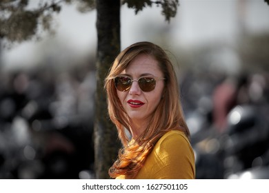 24-04-2019 Riga, Latvia. Young beautiful girl in stylish sunglasses