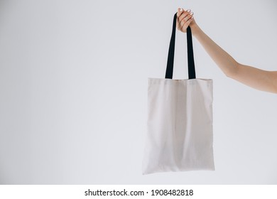 24.06.2020 Vinnitsa, Ukraine: hand of young women with white cotton bags in hand on a white background