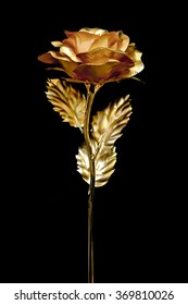 24K Golden rose blooming with stem and leave, isolated, dark background