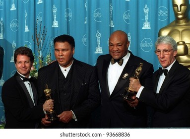 """24MAR97:  MUHAMMED ALI (left) & GEORGE FOREMAN with the makers of  the documentary """"When They Were Kings,"""" at the Academy Awards. Pix: PAUL SMITH"""