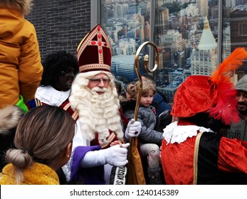 24-November-2018, The Hague, Netherlands, Europe. Celebrating the arrival of Dutch Saint Nicholas, called Sinterklaas, with his assistants, Black Petes, in The Hague.