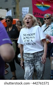 """The 24th Annual NYC Dyke March. June 25, 2016. New York City, New York.  Washington Square Park.  Older woman wears shirt that  says """"Nobody Knows that I am lesbian."""""""
