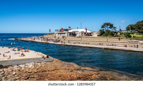 24th December 2018, Clovelly Sydney Australia: Clovelly bay and beach full of people with surf lifesaving club view in Sydney NSW Australia