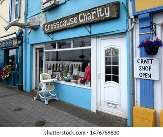 24th July 2019, Dundalk, Ireland. Crosscause Charity Shop with elephant trunk on shopfront and baby chair outside in Blackrock, Dundalk, County Louth.