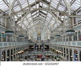 24th October 2018 Dublin. Shopping theme. Inside of St Stephens Green Shopping Centre, Grafton Street, Dublin, showing glass ceiling structure and glass clock in centre.