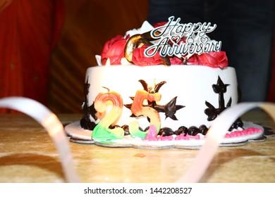 25 Aniversary cake with ribbon