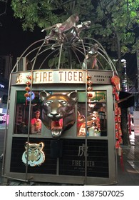 25 April 2019; Siam Square road, Bangkok Thailand: Front of Fire Tiger Bubble Milk Tea shop. Fire tiger milk tea is a franchise milk tea drink shop in Thailand.