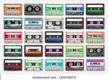 25 audio cassettes isolated on white background.