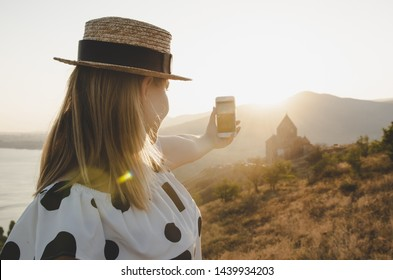 25 august 2018 - Sevan Armenia: young woman taking photo with iphone 8 in Armenia